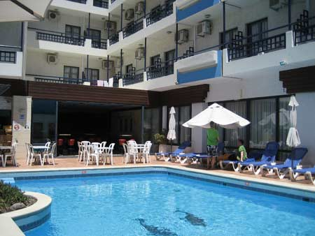 The Agrabella hotel pool and courtyard